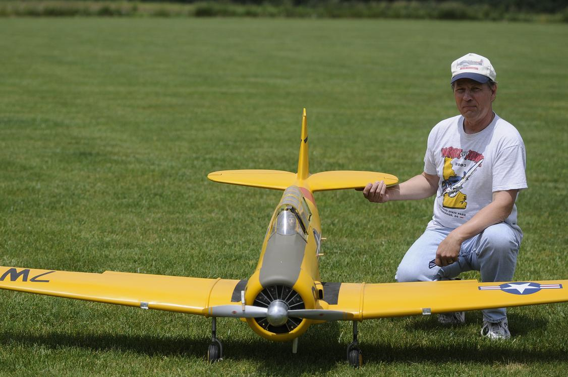 "Charles Kellogg of Warrington, PA displays his 101"" SNJ-5 Texan weighing in at 28 lbs. and powered by a G-62."