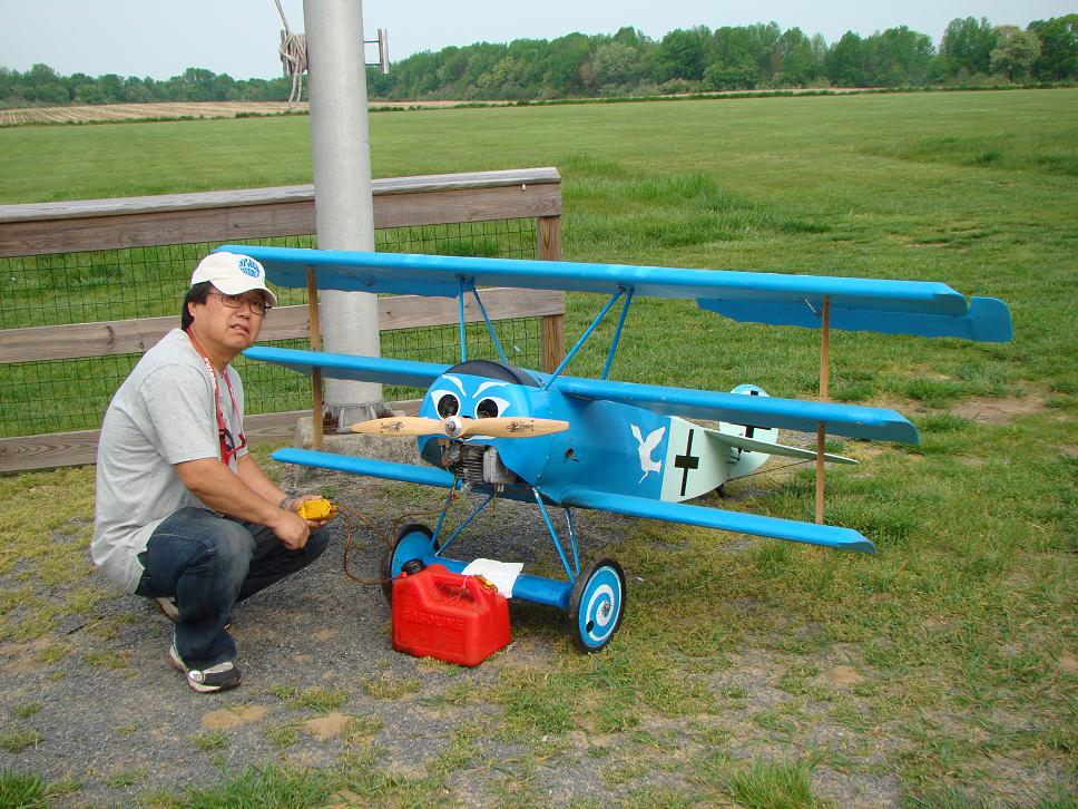 "Nobu Iwasawa from South River, NJ with his 96"" Fokker DR-1 WW1 tri-plane weighing in at 30 pounds."