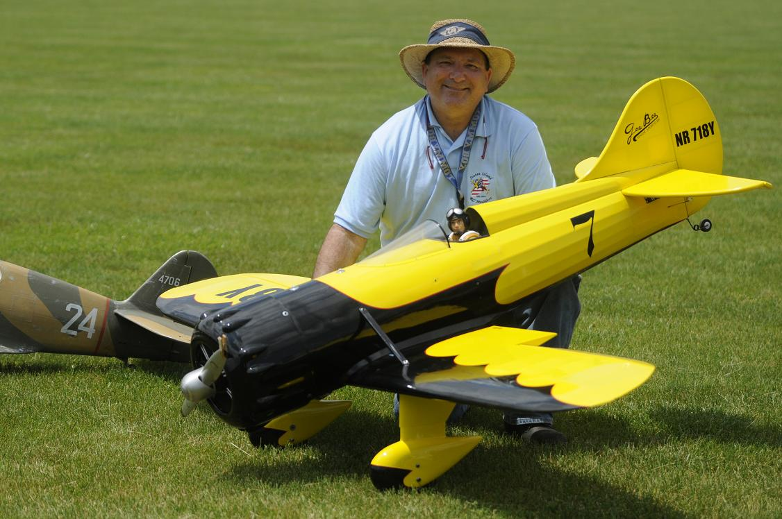 "Dan Baskovitch of Staten Island NY poses with his 96"" Gee Bee Y weighing 20 lbs. Complete with smoke system, he put on quite a show. Dan also brought his 96"" Giant Stick."