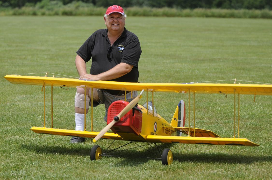 "Ken Kardinsky from Philadelphia PA with his WWI era 105"" wingspan JN 4 Jenny bi-plane powered by a CRRC 50. Ken also brought his 83""  ""Incredibly Ugly Stick""."