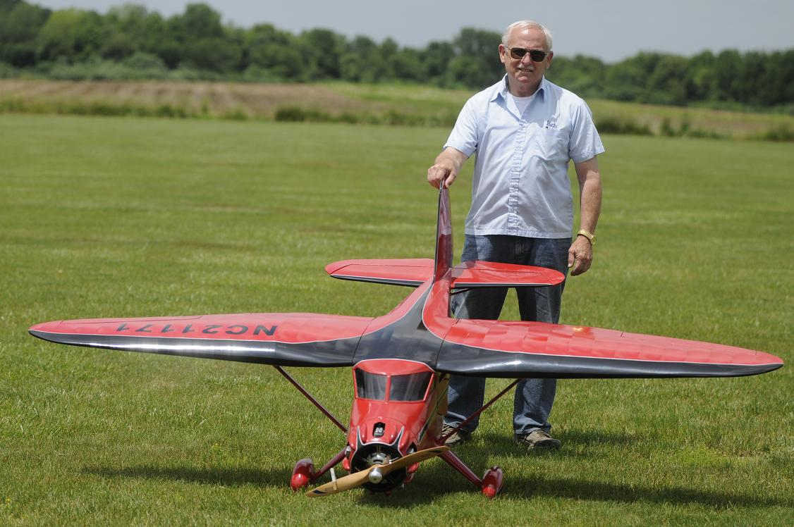 "Richard Blatt of Greenbrook NJ displays his 100.5"" Stinson SR9 complete with flaps and powered by a 4-stroke O.S. Sirius 5 cylinder engine."